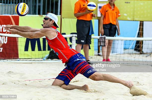 John Hyden of USA receives the Mikasa during the 3rd day of the FIVB Antalya Open beach volley tournament May 12 in the Mediterranean resort city of...