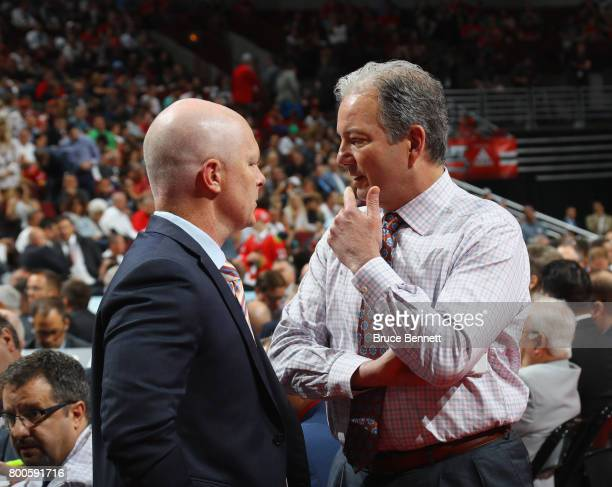 John Hynes and Ray Shero of the New Jersey Devils attend during the 2017 NHL Draft at the United Center on June 24 2017 in Chicago Illinois