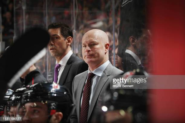 John Hynes of the New Jersey Devils works the bench against the New Jersey Devils at the Prudential Center on February 19 2019 in Newark New Jersey...
