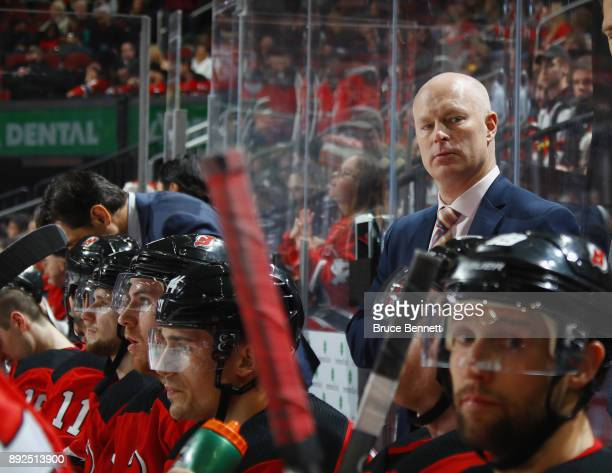 John Hynes of the New Jersey Devils works the game against the Los Angeles Kings at the Prudential Center on December 12 2017 in Newark New Jersey