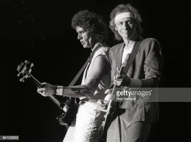 John Illsley and Mark Knopfler from Dire Straits perform live on stage at Ahoy Rotterdam Holland on May 25 1985