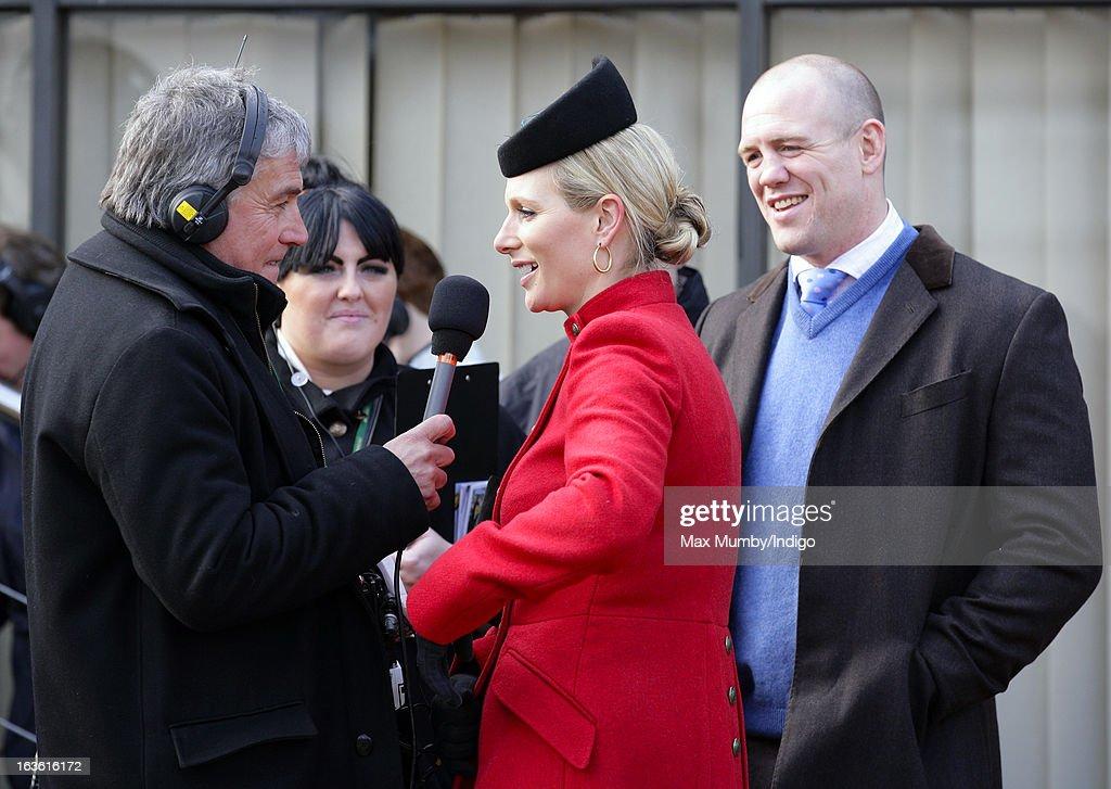 John Inverdale interviews Zara Phillips, whilst husband Mike Tindall looks on, on Day 2 of The Cheltenham Festival at Cheltenham Racecourse on March 13, 2013 in London, England.