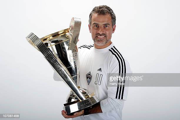 John Ireland team Fitness Coach of the Colorado Rapids poses with the Philip F Anschutz MLS Cup trophy following the MLS Cup final at BMO Field on...