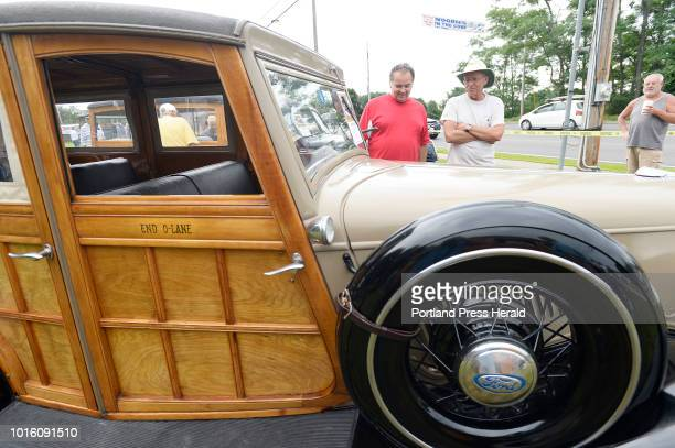 John Irving right of Jericho Vermont shows of his 1934 Ford Woody to Geatan Rennaud of Montreal during The 7th annual Woodies in the Cove Car Show...