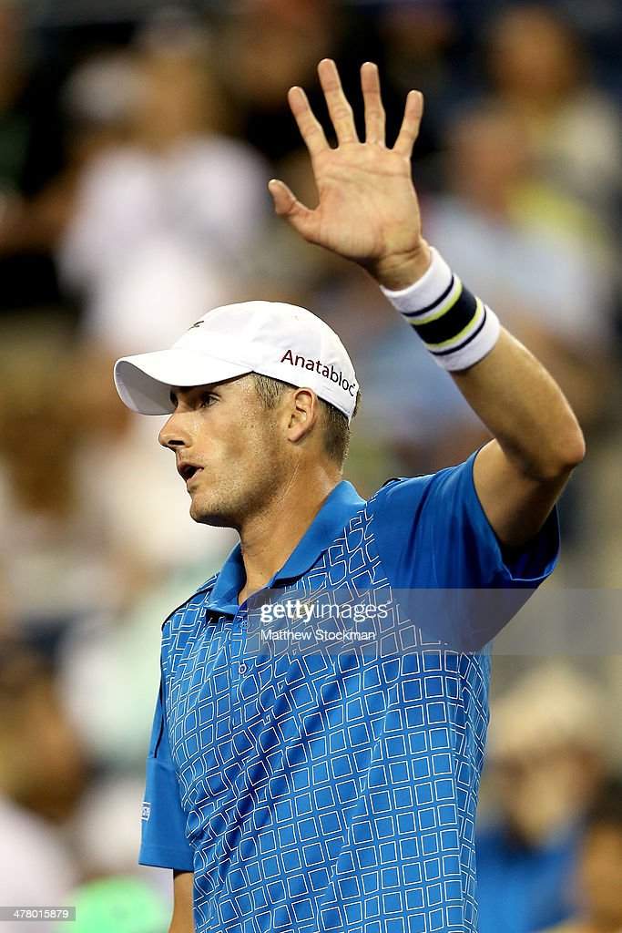 John Isner acknowledges the crowd after his win over Yen-Hsun Lu of Taipei during the BNP Parabas Open at the Indian Wells Tennis Garden on March 11, 2014 in Indian Wells, California.