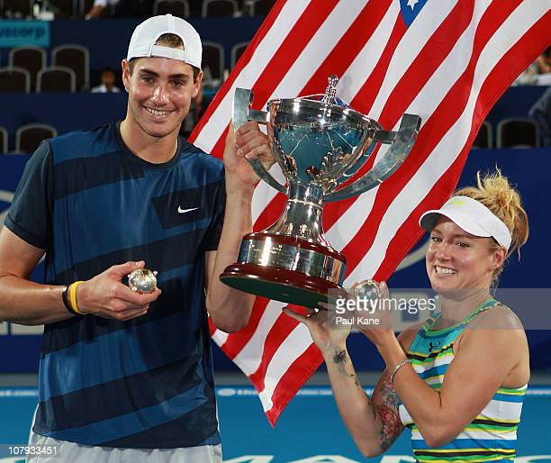 John Isner and Bethanie MattekSands of the USA hold the Hopman Cup trophy after defeating Justine Henin and Ruben Bemelmans of Belgium in the final...