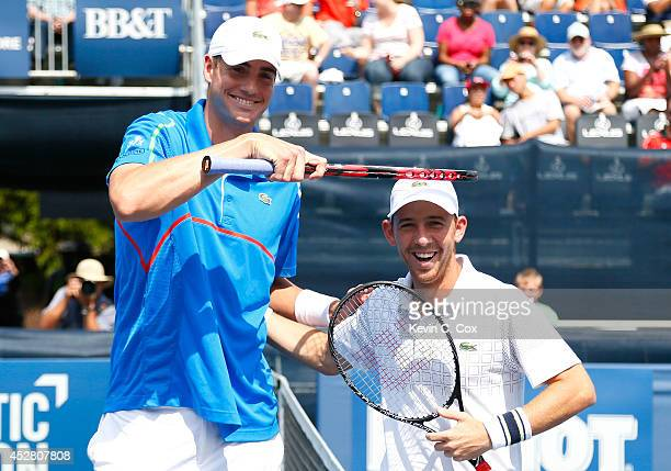 John Isner and Dudi Sela of Israel enjoy a laugh as they pose prior to the finals of the BBT Atlanta Open at Atlantic Station on July 27 2014 in...