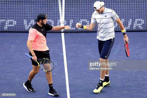 John Isner and Jack Sock celebrate a point against Oliver Marach and Mate Pavic during the doubles semifinals of the BNP Paribas Open at the Indian...