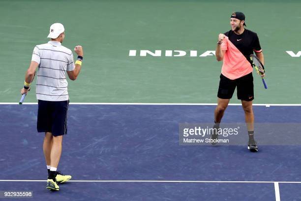 John Isner and Jack Sock celebrate breaking Oliver Marach and Mate Pavic during the doubles semifinals of the BNP Paribas Open at the Indian Wells...
