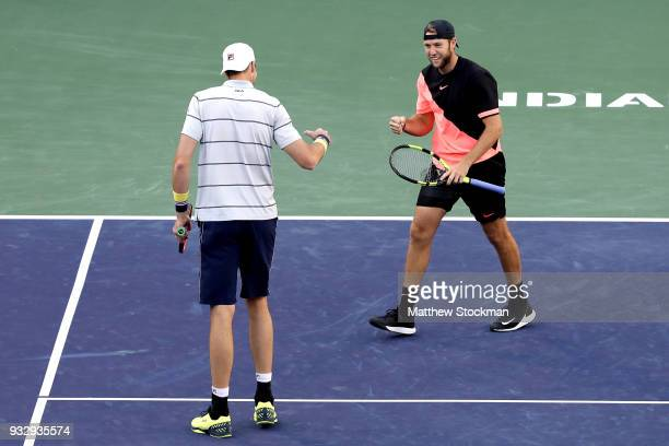 John Isner and Jack Sock celebrate breaking point against Oliver Marach and Mate Pavic during the doubles semifinals of the BNP Paribas Open at the...