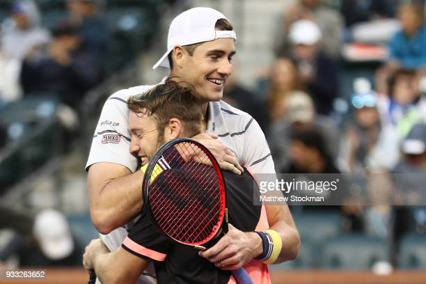 John Isner and Jack Sock celebrate match point aganst Mike Bryan and Bob Bryan during the men's doubles final on Day 13 of the BNP Paribas Open at...
