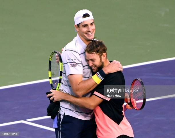 John Isner and Jack Sock of the United States celebrate their ATP doubles final win over Bob Bryan and Mike Bryan of the United States during the BNP...