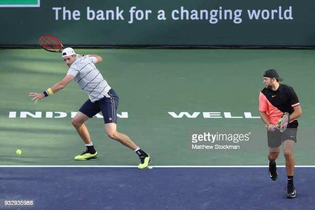 John Isner and Jack Sock play Oliver Marach and Mate Pavic during the doubles semifinals of the BNP Paribas Open at the Indian Wells Tennis Garden on...