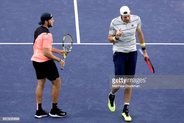 John Isner and Jack Sock react to a point against Oliver Marach and Mate Pavic during the doubles semifinals of the BNP Paribas Open at the Indian...
