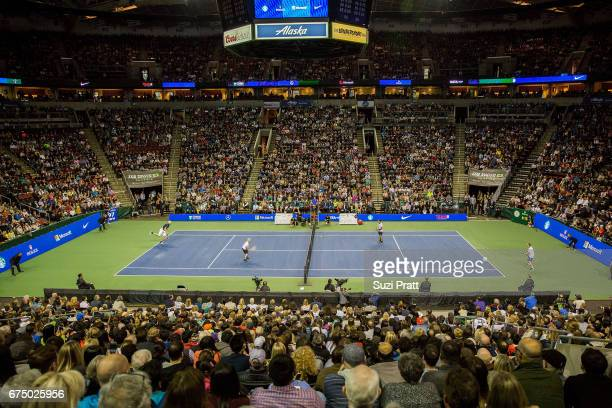 John Isner and Mike McCready in action against Roger Federer and Bill Gates at the Match For Africa 4 exhibition match at KeyArena on April 29, 2017...