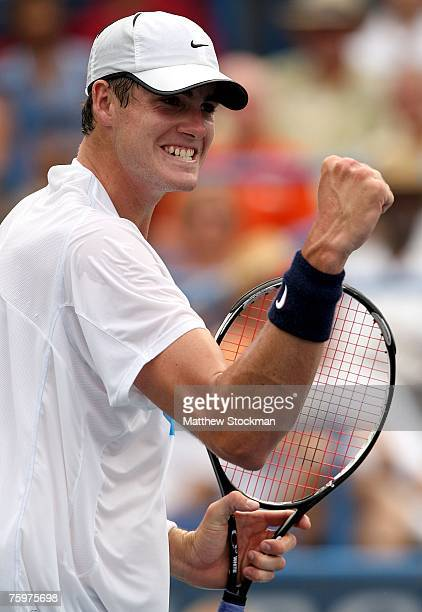 John Isner celebrates a point against Andy Roddick during the final of the Legg Mason Tennis Classic at the William H.G. FitzGerald Tennis Center...