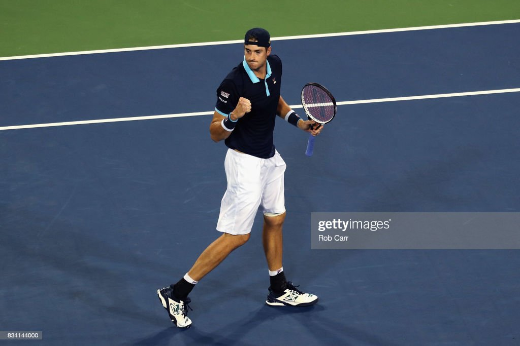 John Isner celebrates after defeating Frances Tiafoe during Day 6 of the Western and Southern Open at the Linder Family Tennis Center on August 17, 2017 in Mason, Ohio.