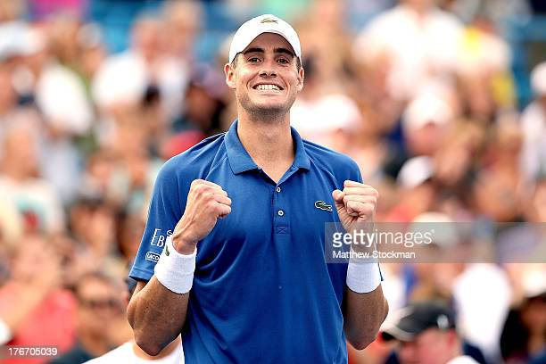 John Isner celebrates his win over Juan Martin Del Potro of Argentina during the semifinals of the Western Southern Open on August 17 2013 at Lindner...