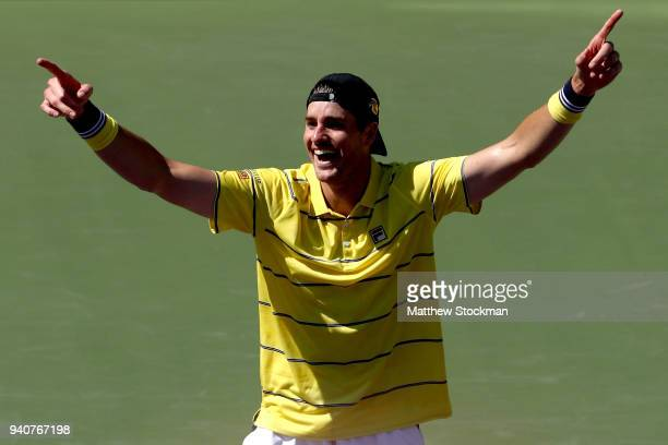 John Isner celebrates match point against Alexander Zverev of German during the men's final of the Miami Open Presented by Itau at Crandon Park...