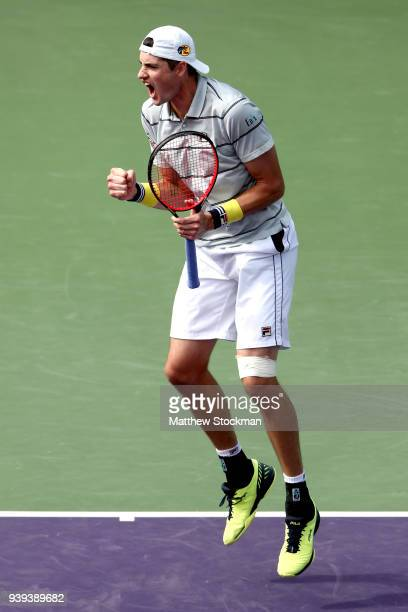 John Isner celebrates match point against Hyeon Chung of Korea during the quarterfinals of the Miami Open Presented by Itau at Crandon Park Tennis...