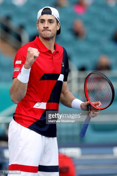 John Isner celebrates match point against Lorenzo Sonego of Italy during the Miami Open Presented by Itau at Hard Rock Stadium March 22 2019 in Miami...