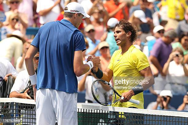 John Isner congratulates Rafael Nadal of Spain after their match during the final of the Western & Southern Open on August 18, 2013 at Lindner Family...