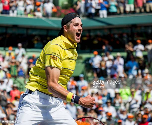 John Isner from the USA celebrates his title at the Miami Open his first ATP Master 1000 Isner defeated Zverez 67 64 64 in Key Biscayne on April 1...