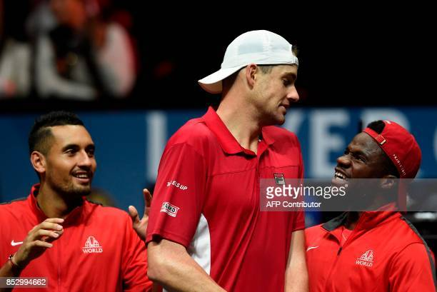 US John Isner of Team World and his teamamtes celebrate after a match against Spanish Rafael Nadal of Team Europe during third day of Laver Cup on...