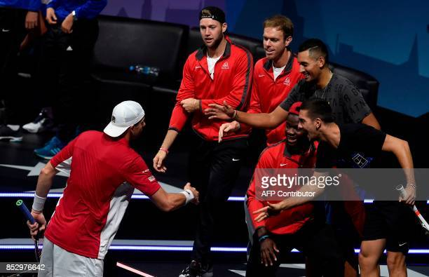 US John Isner of Team World and his teamamtes react during a match against Spanish Rafael Nadal of Team Europe during third day of Laver Cup on...