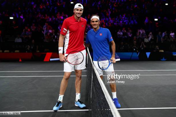 John Isner of Team World and Roger Federer of Team Europe pose for a photo prior to their singles match during Day Three of the Laver Cup 2019 at...