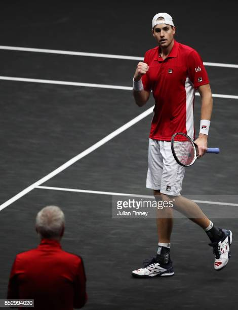 John Isner of Team World celebrates winning match point during his mens singles match against Rafael Nadal of Team Europe on the final day of the...
