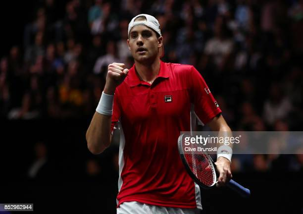 John Isner of Team World celebrates winning the first set during his mens singles match against Rafael Nadal of Team Europe on the final day of the...