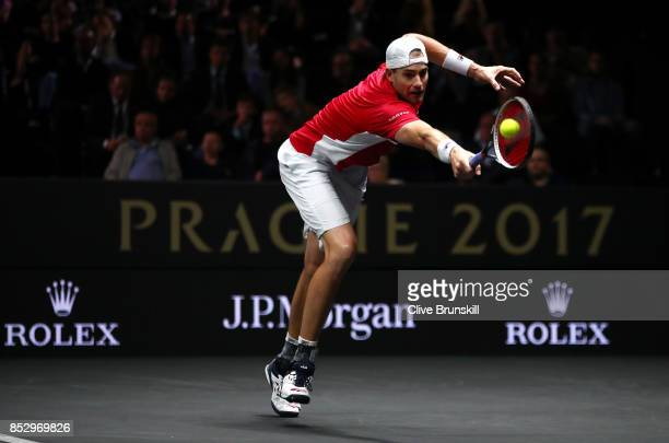 John Isner of Team World plays a backhand during his mens singles match against Rafael Nadal of Team Europe on the final day of the Laver cup on...