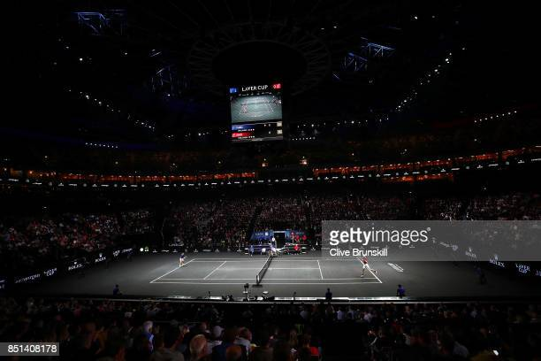 John Isner of Team World plays a backhand during his singles match against Dominic Thiem of Team Europe on the first day of the Laver Cup on...