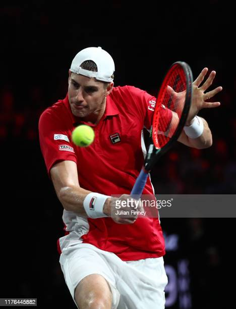 John Isner of Team World plays a backhand in his singles match against Roger Federer of Team Europe during Day Three of the Laver Cup 2019 at Palexpo...