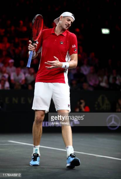 John Isner of Team World reacts in his singles match against Roger Federer of Team Europe during Day Three of the Laver Cup 2019 at Palexpo on...