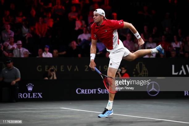 John Isner of Team World serves in his singles match against Roger Federer of Team Europe during Day Three of the Laver Cup 2019 at Palexpo on...