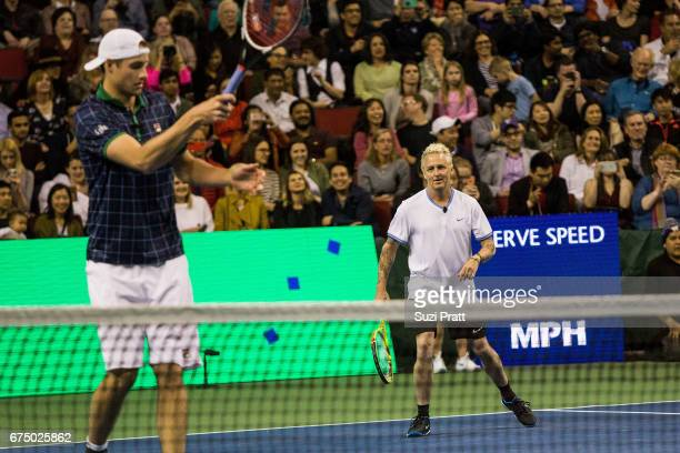 John Isner of the United States and musician Mike MCready in action against Bill Gates and Roger Federer of Switzerland at the Match For Africa 4...