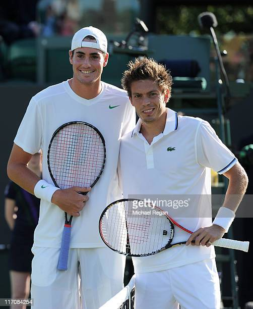 John Isner of the United States and Nicolas Mahut of France pose before their first round match on Day Two of the Wimbledon Lawn Tennis Championships...