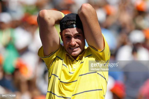 John Isner of the United States celebrates match point after defeating Alexander Zverev of Germany in the men's final on Day 14 of the Miami Open...