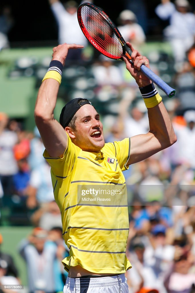John Isner of the United States celebrates match point after defeating Alexander Zverev of Germany in the men's final on Day 14 of the Miami Open Presented by Itau at Crandon Park Tennis Center on April 1, 2018 in Key Biscayne, Florida.