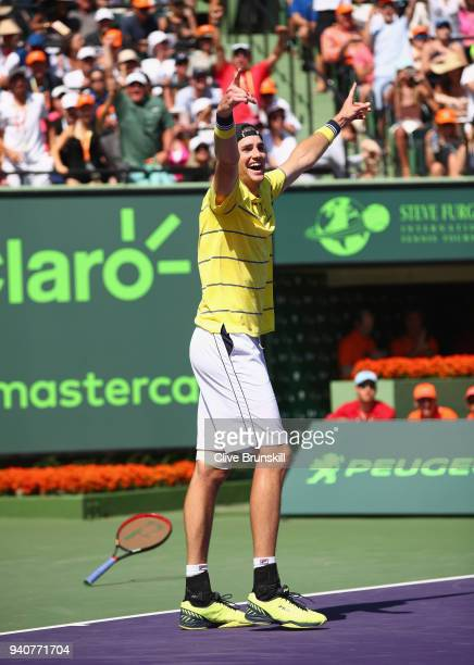 John Isner of the United States celebrates match point against Alexander Zverev of Germany in the mens final during the Miami Open Presented by Itau...