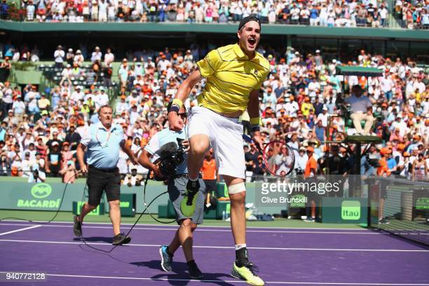John Isner of the United States celebrates to the crowd after his three set victory against Alexander Zverev of Germany in the mens final during the...