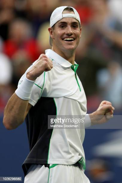John Isner of The United States celebrates victory during the men's singles fourth round match against Milos Raonic of Canada on Day Seven of the...