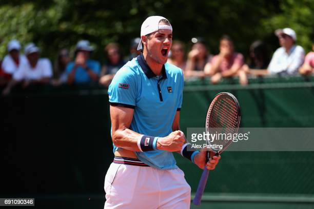 John Isner of The United States celebrates victory following the mens singles second round match against Paolo Lorenzi of Italy on day five of the...