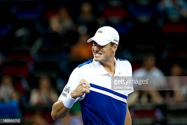 John Isner of the United States celebrates winning against Santiago Giraldo of Columbia during day one of the Shanghai Rolex Masters at the Qi Zhong...