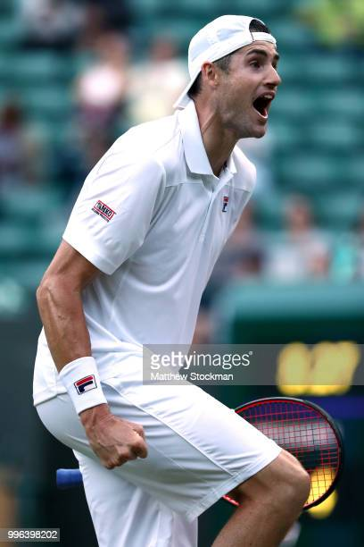 John Isner of the United States celebrates winning match point against Milos Raonic of Canada during their Men's Singles QuarterFinals match on day...