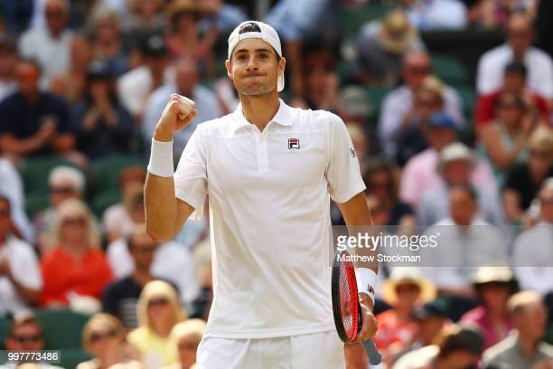 John Isner of The United States celebrates winning the third set against Kevin Anderson of South Africa during their Men's Singles semifinal match on...