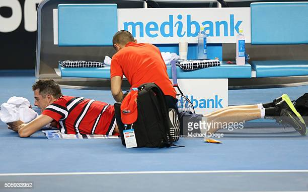 John Isner of the United States gets medical attention in between games in his second round match against Marcel Granollers of Spain during day four...