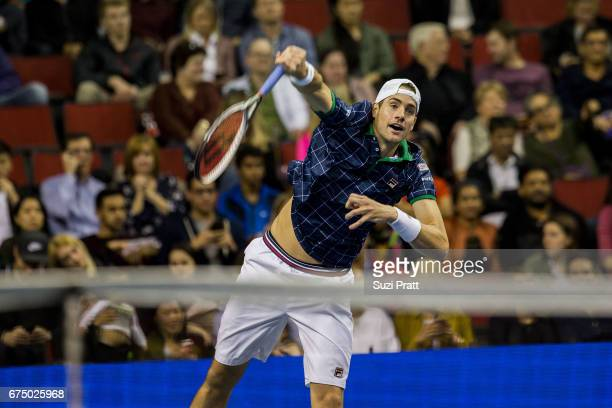 John Isner of the United States hits a serve against Roger Federer of Switzerland at the Match For Africa 4 exhibition match at KeyArena on April 29,...